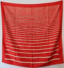 HERMES Paris  Carré en soie imprimée à décor de rayures bleues sur fond rouge vif .