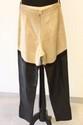 HERMES - Pantalon jodhpur en veau velours crème et cuir noir, garniture de boutons dorés ornés d'un cheval ailé,  taille 38. Etat d'usage