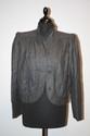 VALENTINO - Tailleur en flanelle gris foncé comprenant un blouson et une jupe à double volants dont un surpiqué , taille 34 / 36 . Vers 1970. Bon état
