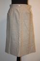 COURREGES - Jupe en flanelle gris clair, deux poches boutonnées ,   sigle blanc sur la ceinture, taille 38. Vers 1970. Bon état.