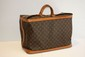 VUITTON - Cruiser bag,toile monogrammée , cuir vachette ,   50x 34 x 25 cm. Bon état