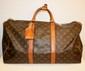 VUITTON - sac modèle keepal 50 cm, toile monogrammée , garniture   en cuir vachette, serre poignée, bon état.