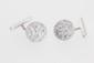 Paire de boutons de manchettes en or ornés de brillants et de diamants baguettes. POIDS 5,8g