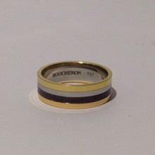 BOUCHERON   Bague quatre classique en or jaune, or blanc, or rose et PVD marron  P : 6 g