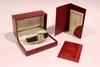 CARTIER Must  Montre ,cadran rond plaqué or ,  bracelet en cuir marron, chiffres romains, dans son écrin avec certificat de garantie