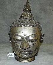 Silvered metal Buddha head. H:16.5