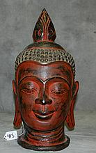 Carved painted wood Buddha head. H:17.5