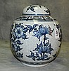Oriental covered porcelain ginger jar. H:11