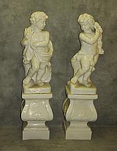 Pair large ceramic putti figures on matching stands.