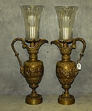 19th C bronze ewers in relief converted into lamps.