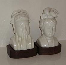 Pair of Blanc de Chine busts on hardwood stands