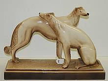 Pair Deco porcelain dogs. H:15
