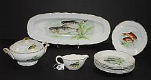 Eleven piece French porcelain fish set . Platter size