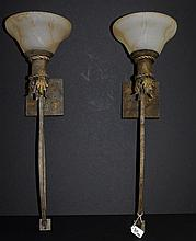 Pair iron wall sconces with frosted glass shades. H:24