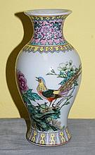 Antique Chinese porcelain vase with mark on bottom.