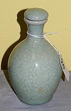 Crackle glazed bottle with lid. H:5. 5