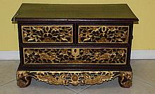 Chinese heavily carved gilt three droor low chest.