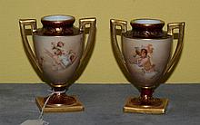 Pair 19th C Royal Viena porcelain urns artist signed.