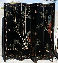 Large Chinese black laquered 6 panel coromandel screen.