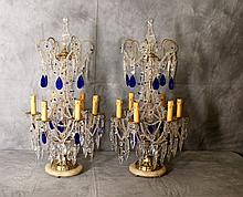 Pr 19th C bronze and crystal 6 light girandoles with clear and blue crystals.