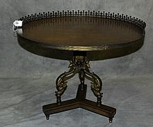 Antique Mahogany table with bronze dolphin base and a