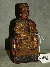 Chinese antique carved polychrome wood seated figure .