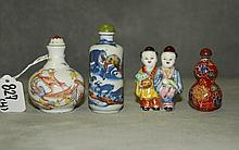 4 Chinese snuff bottles , 3 porcelain and 1 enamel.