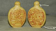 2 Chinese carved ivory colored snuff bottles . H:3