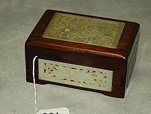 Chinese wood covered box with 5 jade plaques. H:2.5