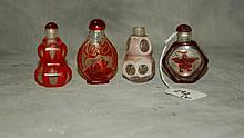 4 Chinese colored g;ass snuff bottles. H:2.75