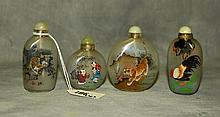 4 Chinese reverse paiinted snuff bottles. H:3.25