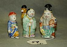 Three Chinese antique figural porcelain snuff bottles.