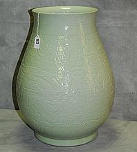 Large Chinese celedon porcelin vase with dragon design.