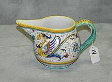 Painted pottery pitcher signed Dervta Italy. H:4.75