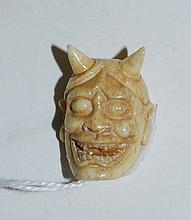 Chinese marine ivory miniature face of devil.