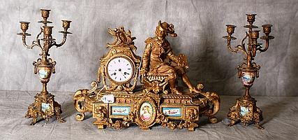 Three piece 19th C bronzed clock set with porcelain