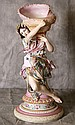 Painted Parian porcelain figure holding a seashell,
