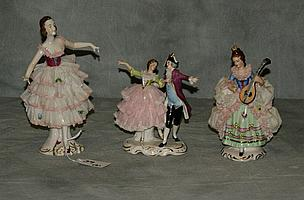 Three Dresden porcelain figural groups. Largest H:7.5