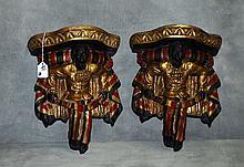 Pair venetian painted blackamoor wall brackets. H:12.5