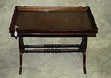 Mahogany glass top tray table.