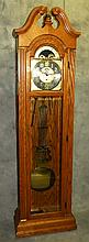 Oak grandfather clock by Heirloom.