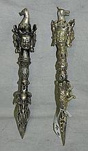 Two Tibetan figural silvered bronze daggers. L:14. 5