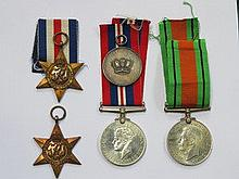TWO WORLD WAR II MEDALS AND WORLD WAR II STAR PLUS