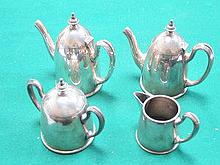 FOUR PIECE SILVER PLATED TEA SET BY REED & BARTON