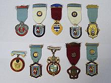 PARCEL OF TEN ENAMELLED STEWARD CHARITY JEWELS
