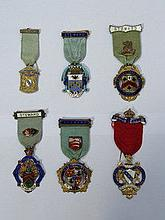 SIX VARIOUS SILVER GILT AND ENAMELLED CHARITY JEWE