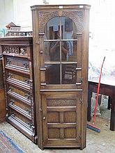 PRIORY STYLE CARVED OAK GLAZED CORNER CUPBOARD