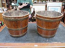PAIR OF BRASS BOUND OAK BARREL FORM PLANTERS