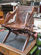 HEAVILY CARVED OAK GOTHIC STYLE X FRAMED ARMCHAIR