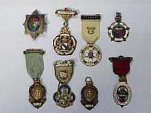 EIGHT VARIOUS SILVER GILT AND ENAMELLED CHARITY JE